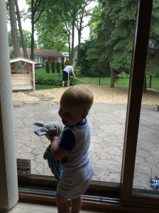 Daddy's biggest fan- this is a common sight, at our house, Karl outside working and Ricky standing watch at the window.